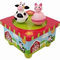 Muziekdoos boerderij dansende koe en varken